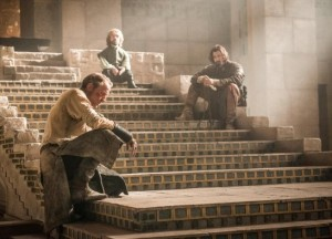 Jorah, Tyrion and Daario wait for the Queen's return